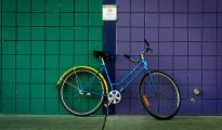 a bicycle infront of coloured tiles